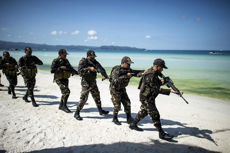 Policemen take part in a security measures exercise on the Philippine island of Boracay island on April 25, 2018.
