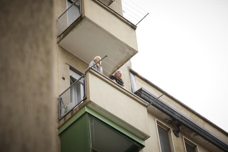 People spend a lot of time on balconies or looking out of windows due to quarantine restrictions during the COVID-19 pandemic in Italy. Source: Getty Images