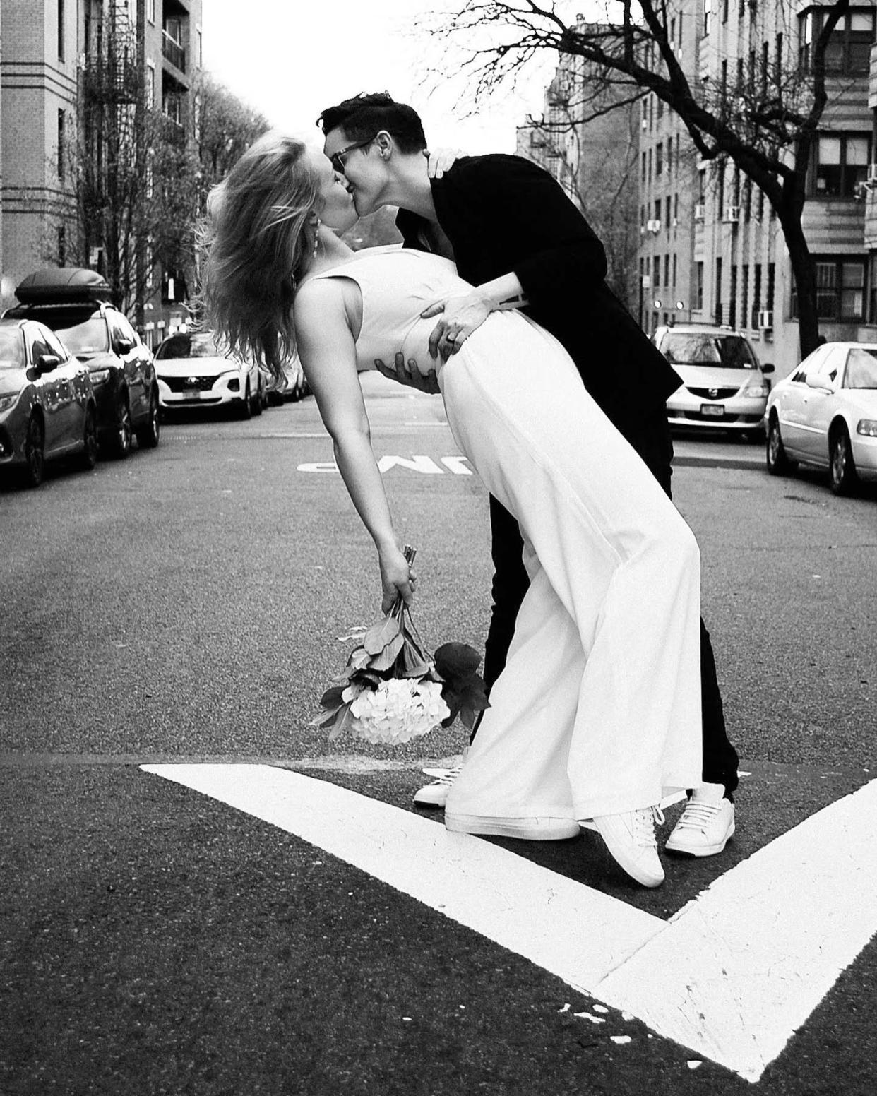 Image: Reilly Jennings and Amanda Wheeler kiss after their wedding in New York. (Katie Kaufman-Gibbons)