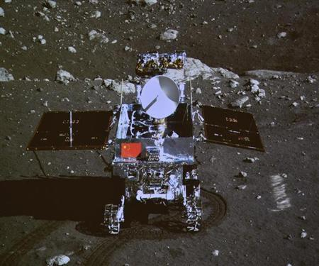 "A photograph of the giant screen at the Beijing Aerospace Control Center shows photo of the Yutu, or ""Jade Rabbit"" lunar rover taken by the camera on the Chang'e 3 probe during the mutual-photograph process, in Beijing"