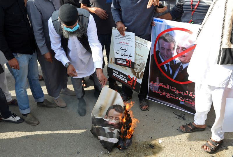 FILE PHOTO: People gather to protest against the publications of a cartoon of Prophet Mohammad