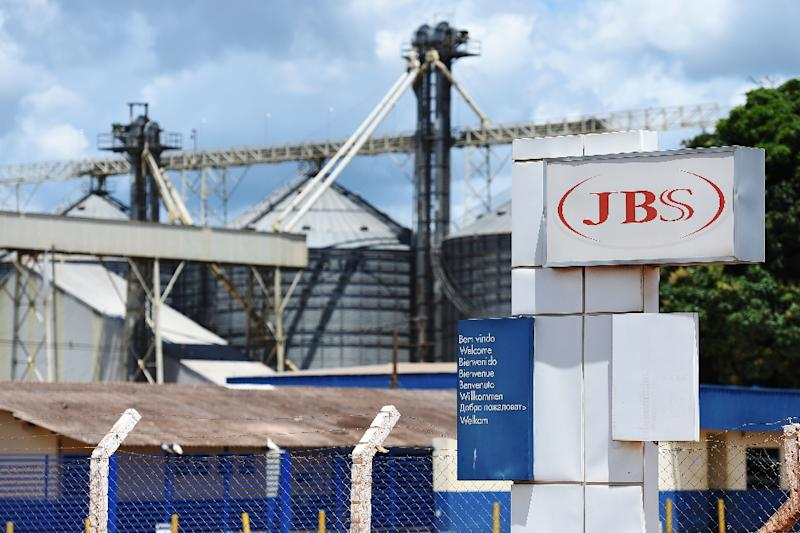 View of the JBS-Friboi Logo at the chicken processing plant entrance, in Samambaia, Federal District, Brazil on March 17, 2017