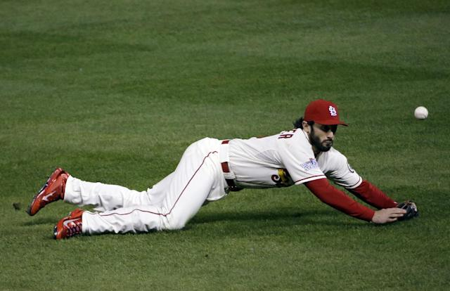 St. Louis Cardinals' Matt Carpenter can't catch a ball hit by Boston Red Sox's Jacoby Ellsbury during the fourth inning of Game 3 of baseball's World Series Saturday, Oct. 26, 2013, in St. Louis. (AP Photo/David J. Phillip)