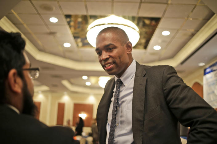 The Democratic candidate for New York's 19th District, Antonio Delgado, speaks to people after a candidate forum in Poughkeepsie, N.Y., Wednesday, Oct. 17, 2018. Hip-hop, health care and Brett Kavanaugh have emerged as issues in a too-close-to-call congressional race in New York's Hudson Valley that pits the freshman Republican congressman against a rapper-turned-corporate lawyer seeking his first political office. (AP Photo/Seth Wenig)