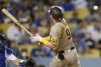 San Diego Padres' Jake Cronenworth (9) reacts after getting hit by a pitch from Los Angeles Dodgers starting pitcher Julio Urias (7) during the third inning of a baseball game Friday, Sept. 10, 2021, in Los Angeles. (AP Photo/Ashley Landis)