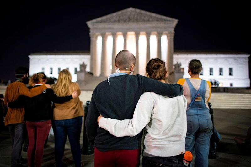 People gather in Washington following the death of Ruth Bader Ginsburg.