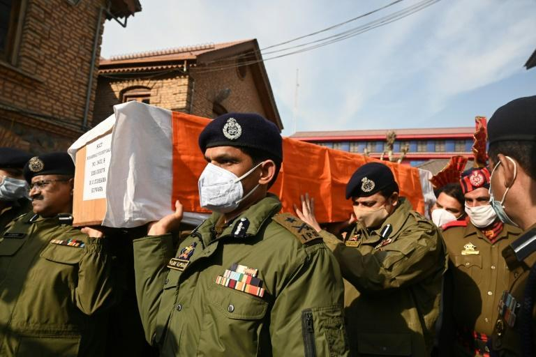 Two policemen were killed in Srinagar when anti-India militants opened fire at point-blank range on a busy street