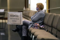 An older Highland Colony Baptist Church member sits in the reserved section for vulnerable adults in the Worship Center in Ridgeland, Miss., Nov. 29, 2020. The church practices covid protocols by allowing families to sit spaced out from others, separating older and more vulnerable members and providing sanitizer and masks at the entrance. (AP Photo/Rogelio V. Solis)