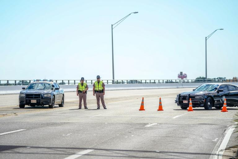 Florida State Troopers block traffic over the Bayou Grande Bridge leading to the Pensacola Naval Air Station following a shooting on December 06, 2019