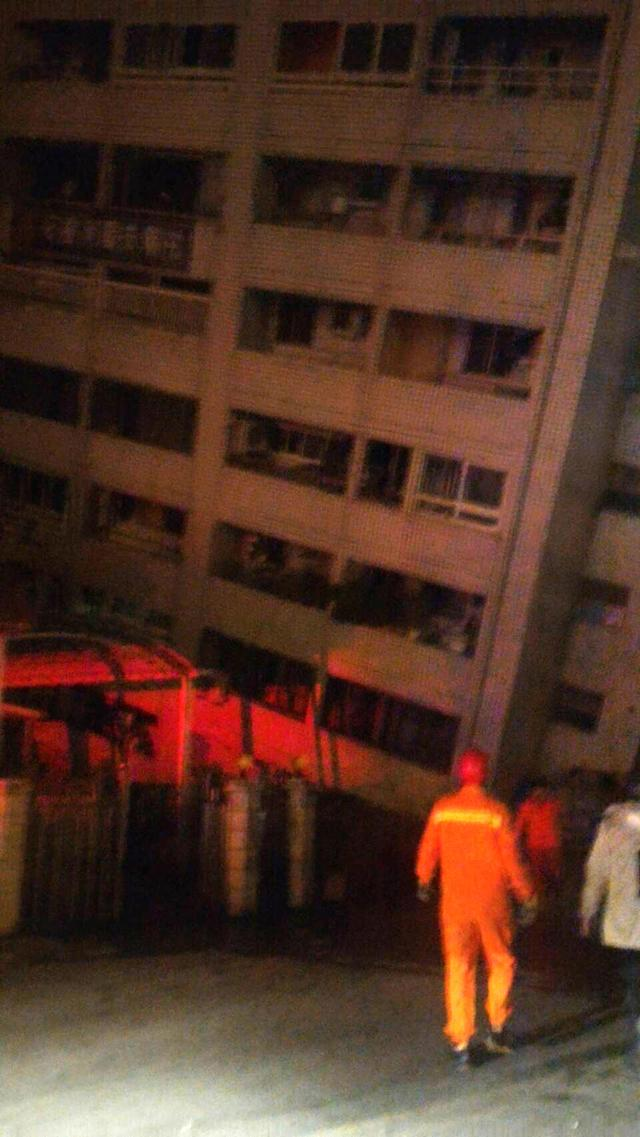 <p>In this photo released by Hualien County Fire Bureau, rescuers are seen entering an building that collapsed on its side from an early morning earthquake in Hualien County, eastern Taiwan, Feb. 7 2018. (Photo: Hualien County Fire Bureau via AP) </p>