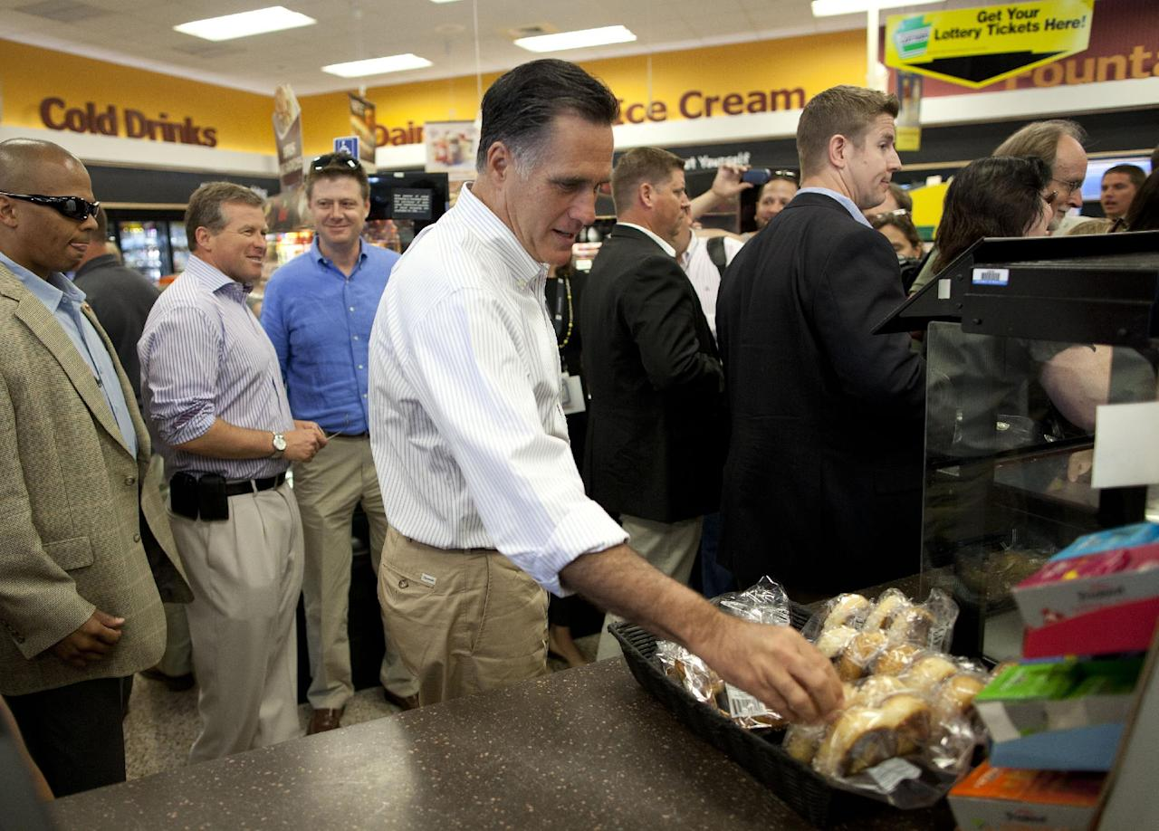 Republican presidential candidate, former Massachusetts Gov. Mitt Romney makes a stop at Wawa gas station in in Quakertown, Pa., Saturday, June 16, 2012. (AP Photo/Evan Vucci)