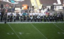 Sep 24, 2017; London, United Kingdom; Jacksonville Jaguars players kneel during the playing of the United Sates national anthem before a NFL International Series game against the Baltimore Ravens at Wembley Stadium. Mandatory Credit: Kirby Lee-USA TODAY Sports