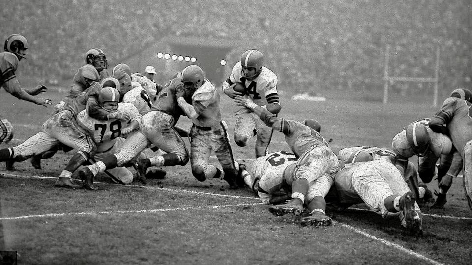 Mandatory Credit: Photo by Uncredited/AP/Shutterstock (10441630a)Cleveland Browns' quarterback Otto Graham goes over from the one yard line to score against the Los Angeles Rams in the NFL championship game, in Los Angeles.