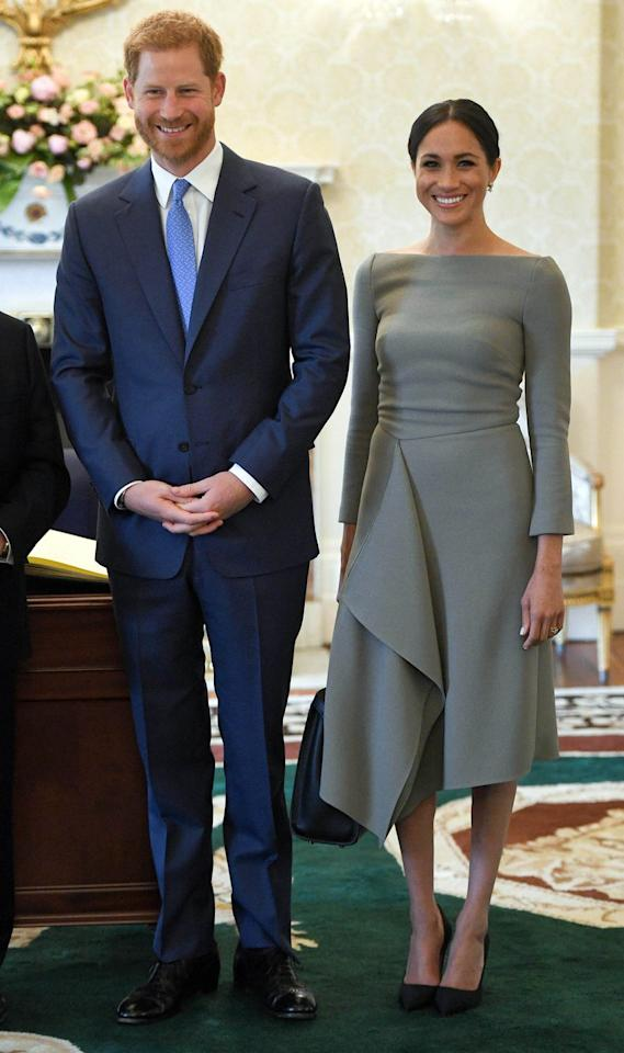 "<p>Harry and Meghan <a rel=""nofollow"" href=""https://www.townandcountrymag.com/society/tradition/g22096025/prince-harry-meghan-markle-dublin-ireland-tour-photos/"">kicked off day two of their royal tour</a> with a visit to the Irish President's residence.  The Duchess wore a bespoke dress by Roland Mouret with a Fendi handbag and a pair of black heels by Paul Andrew. </p><p><a rel=""nofollow"" href=""https://www.net-a-porter.com/us/en/product/497190/fendi/peekaboo-medium-leather-tote"">SHOP SIMILAR</a> <em>Fendi Peekaboo Medium Leather T</em><em>ote, $4,100</em></p>"