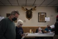 Voters proceed to cast their ballot at the Moose Lodge on Election Day, Tuesday, Nov. 3, 2020, in Kenosha, Wis. (AP Photo/Wong Maye-E)