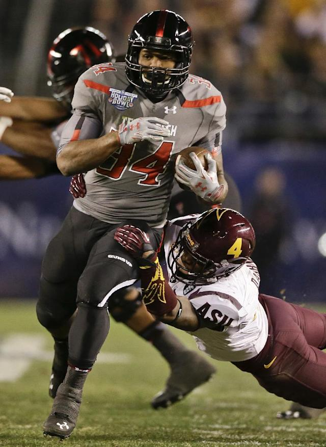 FILE - In this Dec. 30, 2013, file photo, Texas Tech running back Kenny Williams, left, bust through the Arizona State defense for a 17 yard gain during the first half of the Holiday Bowl NCAA college football game in San Diego. The Red Raiders want to run the ball more this season. (AP Photo/Gregory Bull, File)