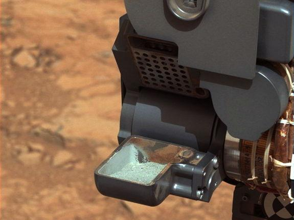 This image from NASA's Curiosity rover shows the first sample of powdered rock extracted by the rover's drill. The image was obtained by Curiosity's Mast Camera on Feb. 20, or Sol 193, Curiosity's 193rd Martian day of operations.
