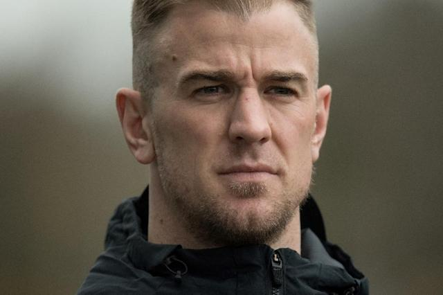 Joe Hart preferred to play cricket for Shrewsbury -- his first match for them in 11 years -- than watch England's 2-0 World Cup quarter-final win over Sweden (AFP Photo/OLI SCARFF)
