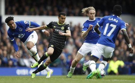 Chelsea's Pedro in action with Everton's Ashley Williams and Tom Davies