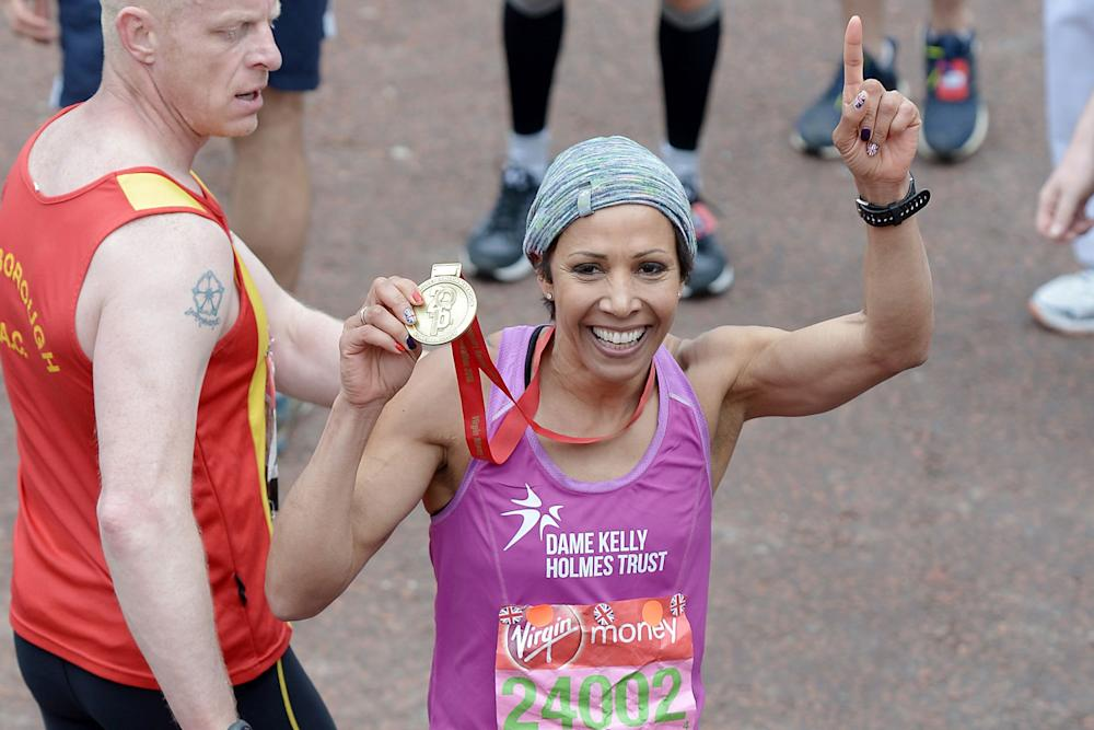 Dame Kelly Holmes poses with her medal after completing the 2016 London Marathon: Jeff Spicer/Getty Images
