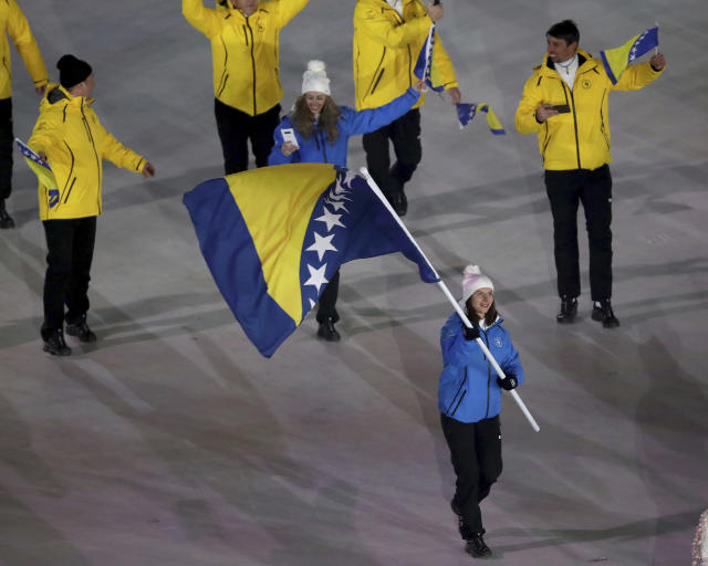 <p>Elvedina Muzaferija carries the flag of Bosnia And Herzegovina during the opening ceremony of the 2018 Winter Olympics in Pyeongchang, South Korea, Friday, Feb. 9, 2018. (Sean Haffey/Pool Photo via AP) </p>