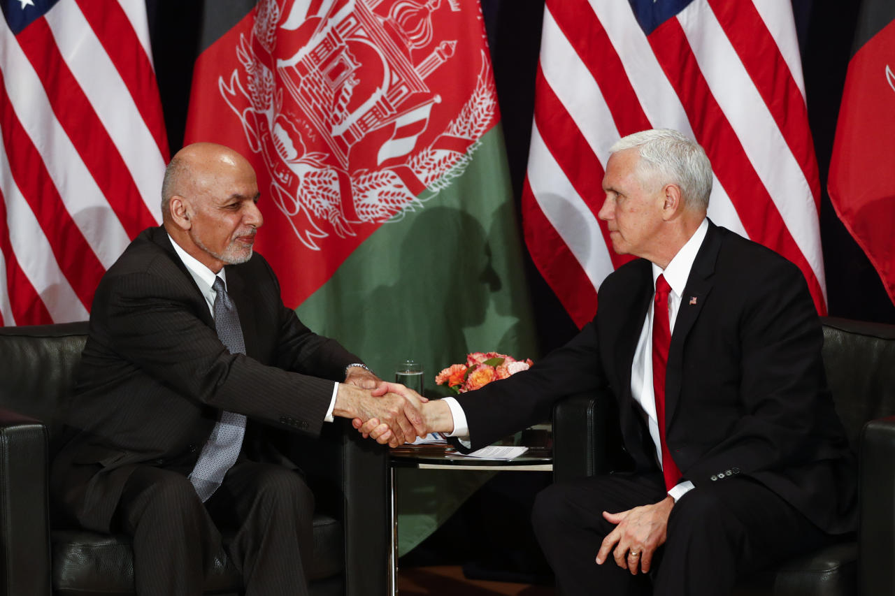 United States Vice President Mike Pence, right, and Afghan President Ashraf Ghani, left, shake hands during a bilateral meeting at the Munich Security Conference in Munich, Germany, Saturday, Feb. 16, 2019. (AP Photo/Matthias Schrader)