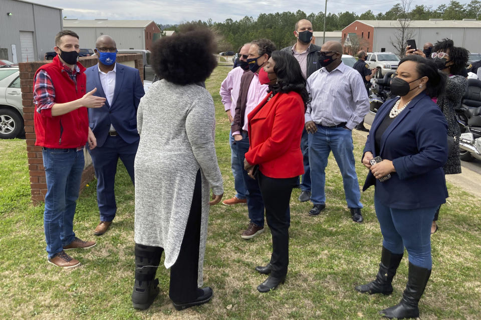 Rep. Terri Sewell, D-Ala, in the center wearing red, and Rep. Nikema Williams, D-Ga., at the far right, join fellow members of Congress, labor organizers and employees at an Amazon facility in Bessemer, Ala., on March 5, 2021. The nearly 6,000 workers at the plant are voting on whether to form a union. The election is the largest unionizing effort ever for Amazon, one of the world's wealthiest firms, and would be a major victory for organized labor and its Democratic Party allies as the labor movement tries to reverse decades of declining membership nationally. (AP Photo/Bill Barrow)