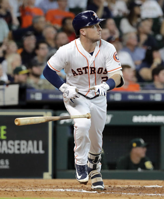 Houston Astros' Alex Bregman drops his bat after hitting a two-run double during the third inning of a baseball game against the Oakland Athletics Thursday, July 12, 2018, in Houston. (AP Photo/David J. Phillip)