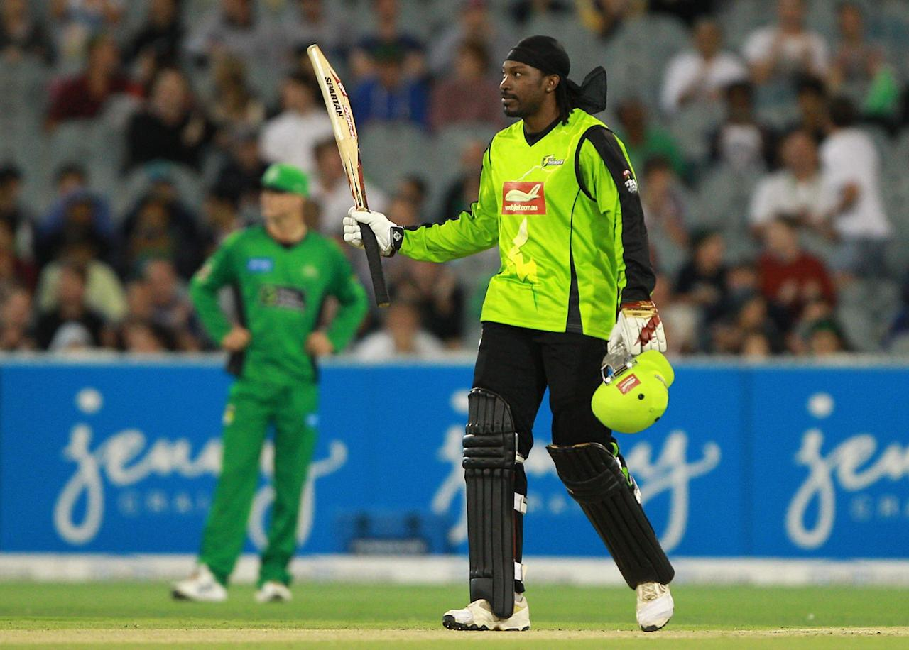 MELBOURNE, AUSTRALIA - JANUARY 08:  Chris Gayle of the Thunder celebrates his half century during the Big Bash League match between the Melbourne Stars and the Sydney Thunder at Melbourne Cricket Ground on January 8, 2013 in Melbourne, Australia.  (Photo by Robert Prezioso/Getty Images)