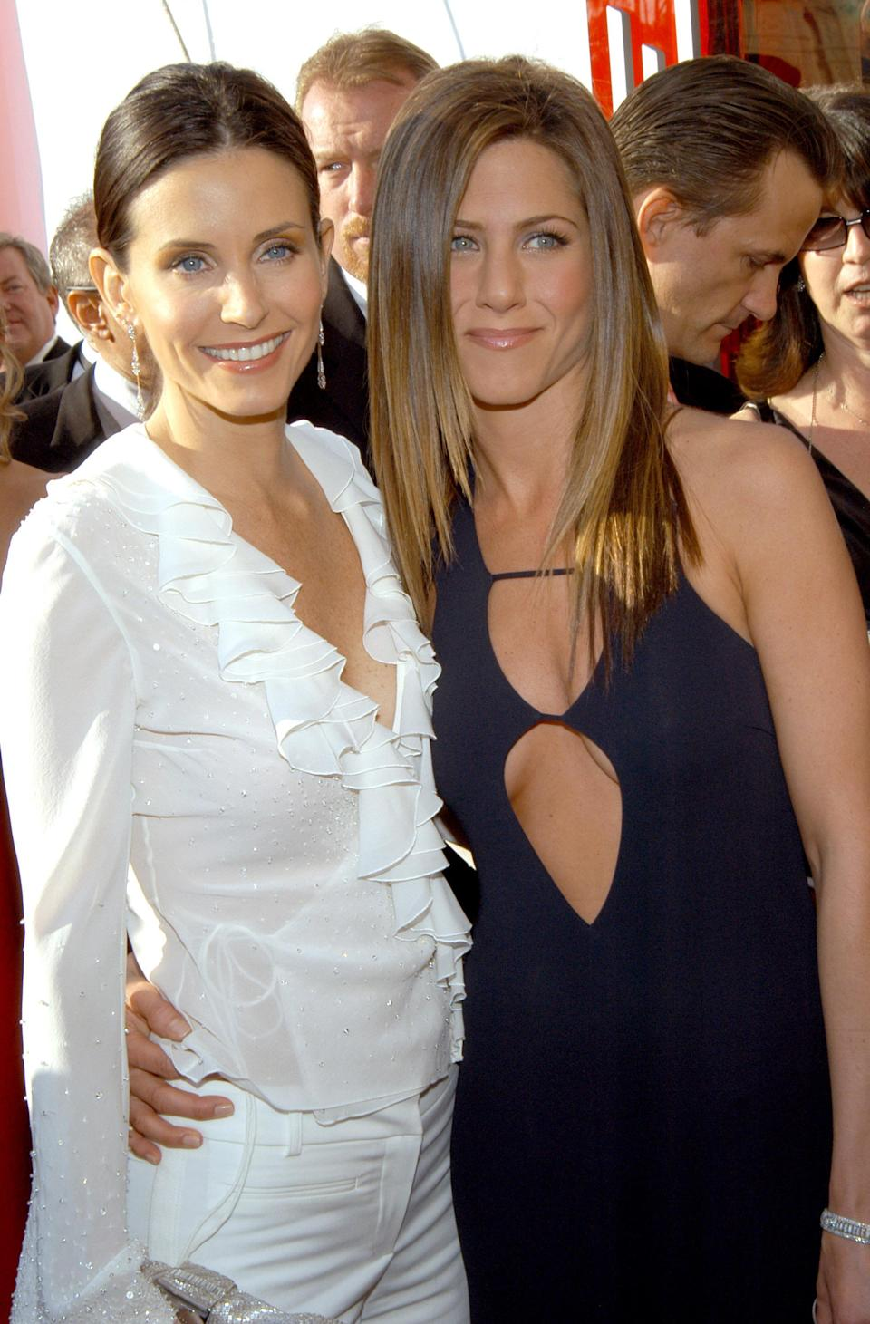 <p>The 2003 Screen Actors Guild awards provided a chance for the friends to showcase their sartorial prowess once again. For the occasion, Jennifer wore a keyhole cut-out black dress while Courteney tucked a ruffled shirt into white trousers. <em>[Photo: Getty]</em> </p>