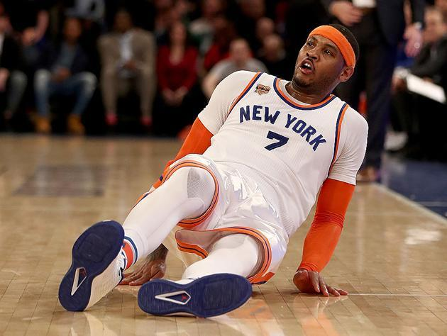 """<a class=""""link rapid-noclick-resp"""" href=""""/nba/players/3706/"""" data-ylk=""""slk:Carmelo Anthony"""">Carmelo Anthony</a> picks himself up. (Getty Images)"""