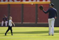 Atlanta Braves' Freddie Freeman works out with his son, Charlie, ahead of the NLCS playoff baseball game, Thursday, Oct. 14, 2021, in Atlanta. (AP Photo/Brynn Anderson)