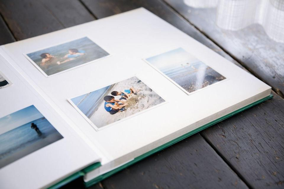 """<p>These days, making a photo album can be as simple as a few clicks on your phone, but there's something to be said for ordering prints, opening up the yellow envelopes, and adding the snapshots one by one to a photo album.</p><p>If you prefer to go the digital route, streamline the process by working together to pick out a print or two to design and frame as custom wall art on platforms like <a href=""""https://www.etsy.com/"""" rel=""""nofollow noopener"""" target=""""_blank"""" data-ylk=""""slk:Etsy"""" class=""""link rapid-noclick-resp"""">Etsy</a> or <a href=""""https://www.mixtiles.com/"""" rel=""""nofollow noopener"""" target=""""_blank"""" data-ylk=""""slk:Mixtiles"""" class=""""link rapid-noclick-resp"""">Mixtiles</a>.</p>"""