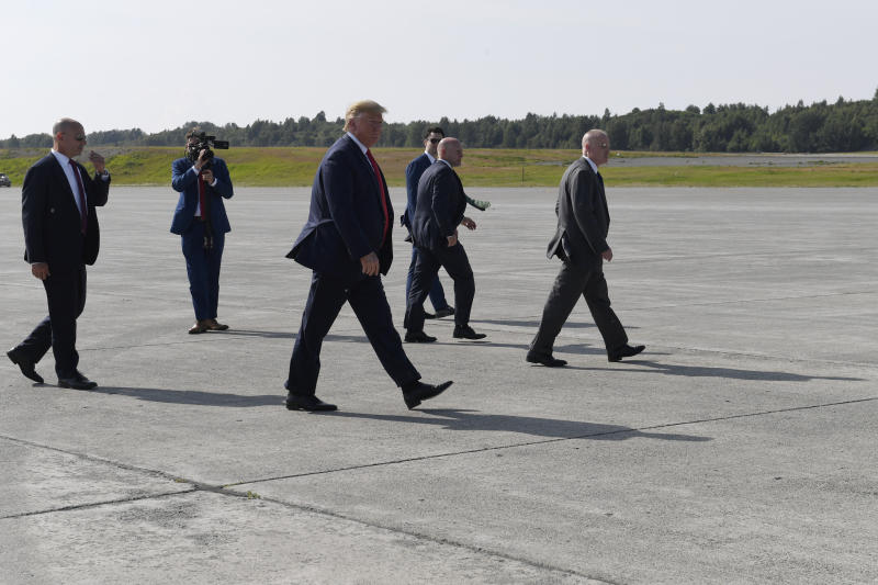 President Donald Trump walks back to Air Force One at Elmendorf Air Force Base in Anchorage, Alaska, Wednesday, June 26, 2019, after greeting troops during a refueling stop. Trump is heading to the G-20 in Japan, his third overseas trip in a month facing a flurry of international crises, tense negotiations and a growing global to-do list. (AP Photo/Susan Walsh)