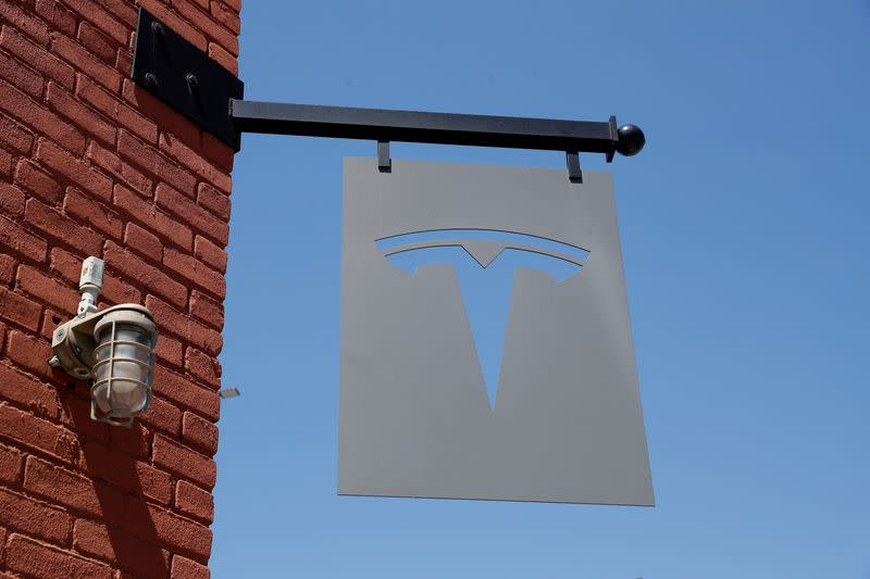 The TESLA logo is seen outside a dealership in the Brooklyn borough of New York City