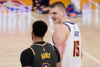 Los Angeles Lakers forward Anthony Davis, left, talks with Denver Nuggets center Nikola Jokic after an NBA basketball game Monday, May 3, 2021, in Los Angeles. (AP Photo/Mark J. Terrill)