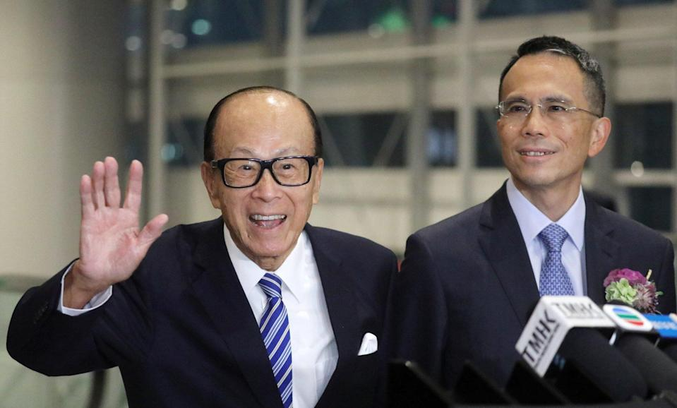 Li Ka-shing, seen here with son Victor Li Tzar-kuoi, saw his fortune grow by US$12 billion to US$33.7 billion last year. He continues to be Hong Kong's wealthiest resident. Photo: Dickson Lee