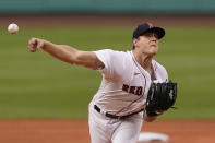 Boston Red Sox starting pitcher Tanner Houck delivers to a New York Yankees batter during the first inning of a baseball game at Fenway Park, Thursday, July 22, 2021, in Boston. (AP Photo/Elise Amendola)