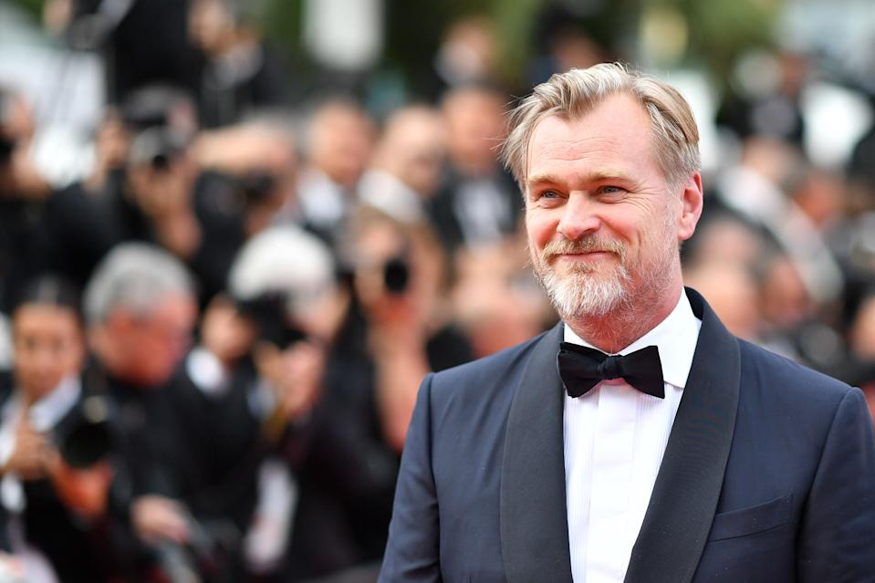 """British director Christopher Nolan arrives on May 13, 2018 for the screening of a remastered version of the film """"2001: A Space Odyssey"""" at the 71st edition of the Cannes Film Festival in Cannes, southern France. (Photo by Alberto PIZZOLI / AFP)        (Photo credit should read ALBERTO PIZZOLI/AFP/Getty Images)"""