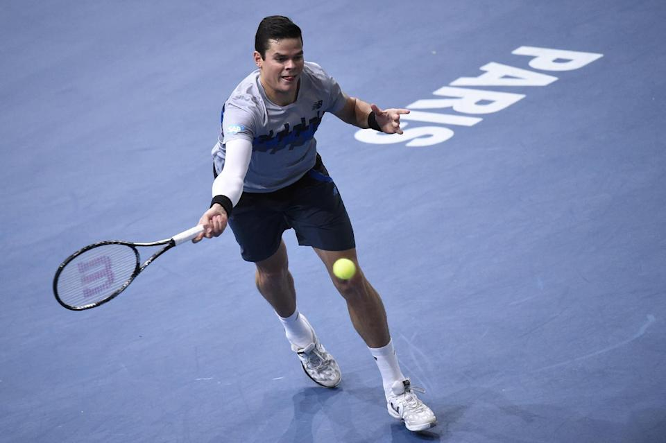 Canada's Milos Raonic returns the ball to Switzerland's Roger Federer during a quarter-final match on October 31, 2014 in Paris (AFP Photo/Franck Fife)