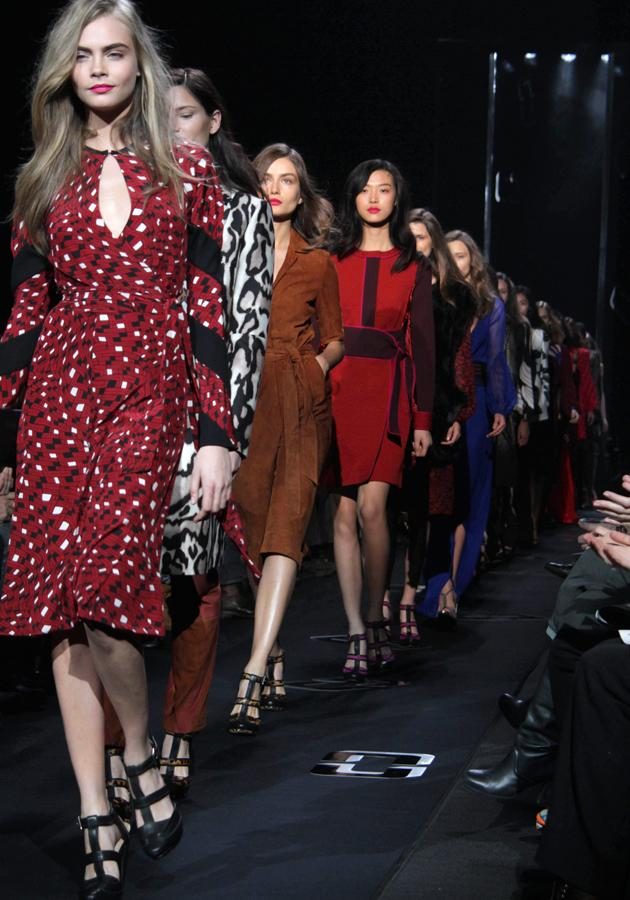 <b>Diane Von Furstenburg AW 13 runway show<br><br></b><br>Cara Delevingne leads the models down the DVF runway at NYFW, showing off bold prints and block colours.<br><br>©Rex<b><br></b>