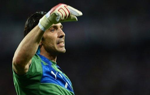 Italian goalkeeper Gianluigi Buffon reacts during the penalty shoot out
