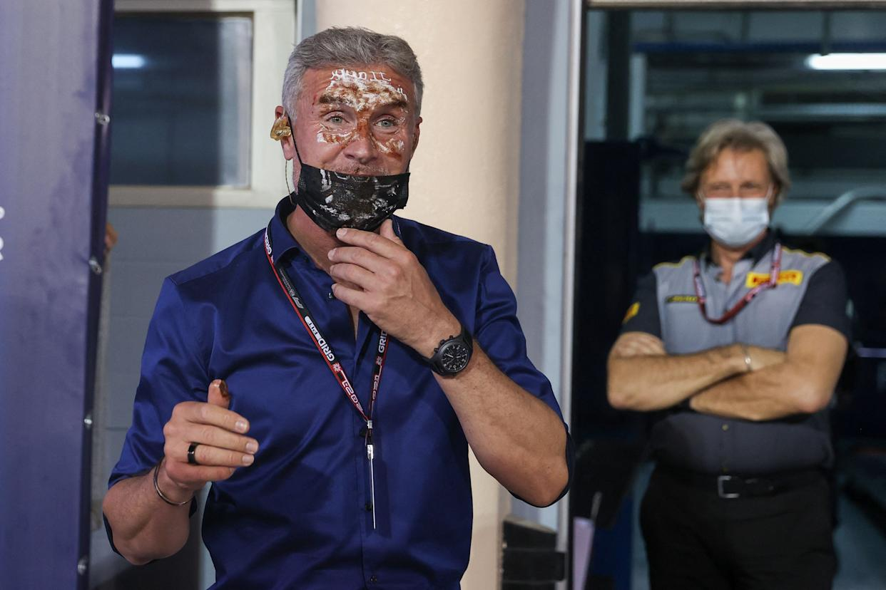 Former F1 driver-turned-pundit David Coulhtard - who is celebrating his birthday - looks on after having cake slammed in his face by Red Bull's Dutch driver Max Verstappen after the qualifying session on the eve of the Bahrain Formula One Grand Prix at the Bahrain International Circuit in the city of Sakhir on March 27, 2021. (Photo by Lars Baron / various sources / AFP) (Photo by LARS BARON/AFP via Getty Images)