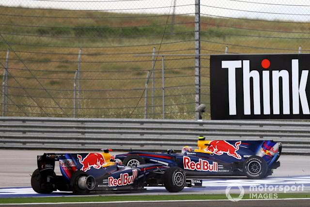 """Mark Webber, Red Bull Racing RB6 Renault and Sebastian Vettel, Red Bull Racing RB6 Renault crash and spin <span class=""""copyright"""">Sutton Motorsport Images</span>"""
