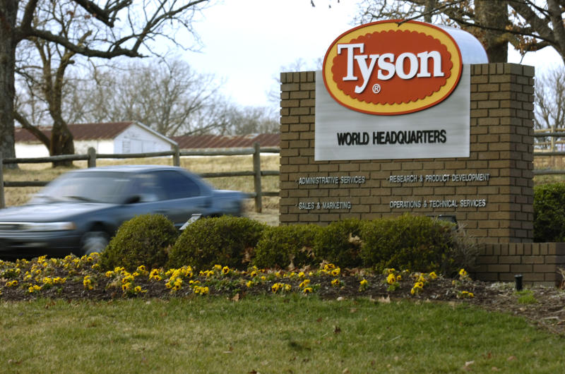 FILE - In this Jan. 29, 2006, file photo a car passes in front of a Tyson Foods Inc., sign at Tyson headquarters in Springdale, Ark.  The president of the Humane Society of the United States said Tuesday, Oct. 2, 2012, that he's seeking a spot on Tyson Foods Inc.'s board of directors in an attempt to convince one of the world's largest meat companies to move away from cramped cages for pregnant pigs. (AP Photo/April L. Brown, File)