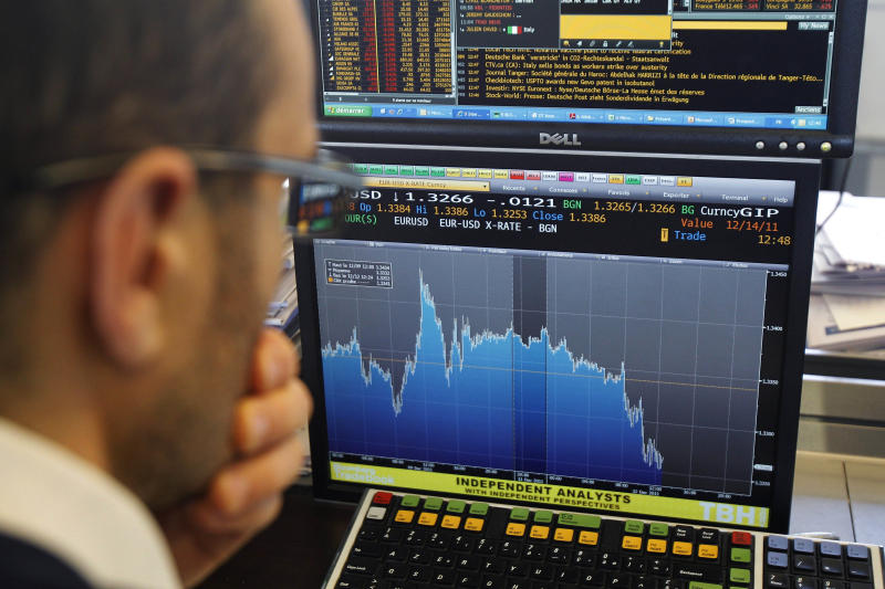 A stock trader checks out a graph showing activity of the euro currency against the US dollar in a business bank, in Paris, Monday, Dec. 12, 2011. Enthusiasm for riskier assets such as stocks and the euro faded Monday as investors worried that Europe's new pact aimed at fixing the continent's debt crisis would be insufficient. (AP Photo/Michel Euler)