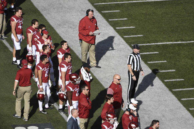 Arkansas coach Bret Bielema walks the sidelines as the Razorbacks play Missouri during the first half of an NCAA college football game Friday, Nov. 24, 2017 in Fayetteville, Ark. (AP Photo/Michael Woods)