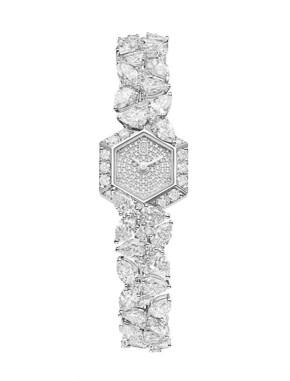 "<p><a class=""link rapid-noclick-resp"" href=""https://www.harrywinston.com/en/products/high-jewelry-timepieces-by-harry-winston/winston-cluster-by-harry-winston-p1/platinum-hjtqhm18pp012"" rel=""nofollow noopener"" target=""_blank"" data-ylk=""slk:SHOP NOW"">SHOP NOW</a></p><p>For the ultimate in precious jewellery watches, Harry Winston has returned to its roots as New York's 'King of Diamonds'. </p><p>The Winston Cluster watch gives a nod to one of the brand's most famous settings, <a href=""https://www.harpersbazaar.com/uk/fashion/jewellery-watches/g36812/10-classic-pieces-of-jewellery-every-woman-should-own/?slide=10"" rel=""nofollow noopener"" target=""_blank"" data-ylk=""slk:the 'Cluster'"" class=""link rapid-noclick-resp"">the 'Cluster'</a>, formulated by the jeweller in the 1940s using pear and marquise-cut diamonds set at varying angles to maximise sparkle. In all, this glamorous timepiece contains 211 diamonds, including 83 brilliant-cut gems in the dial alone. </p><p>Winston Cluster watch, price on request, <a href=""https://www.harrywinston.com/en/products/high-jewelry-timepieces-by-harry-winston/winston-cluster-by-harry-winston-p1/platinum-hjtqhm18pp012"" rel=""nofollow noopener"" target=""_blank"" data-ylk=""slk:Harry Winston"" class=""link rapid-noclick-resp"">Harry Winston</a></p>"