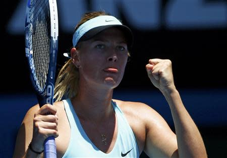 Maria Sharapova of Russia reacts during her women's singles match against Karin Knapp of Italy at the Australian Open 2014 tennis tournament in Melbourne January 16, 2014. REUTERS/David Gray