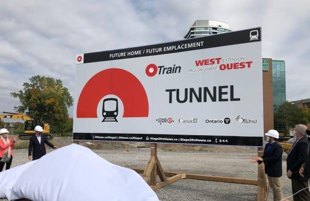 Mayor Jim Watson and other officials attended a ceremonial event kicking off the construction of a three-kilometre tunnel that will run under the Sir John A. Macdonald Parkway and Byron Linear Park. A worker sustained serious injuries in this area on Thursday morning.  (Francis Ferland/CBC - image credit)